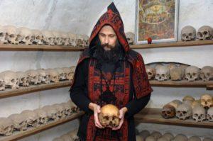 monk with skulls